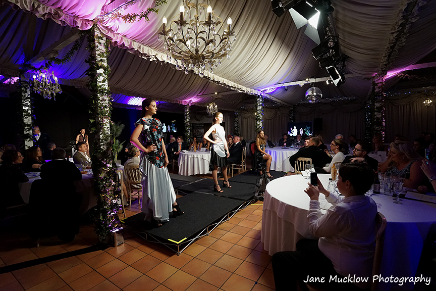 Photograph by Jane Mucklow of models on the catwalk wearing designs by Caroline Bruce