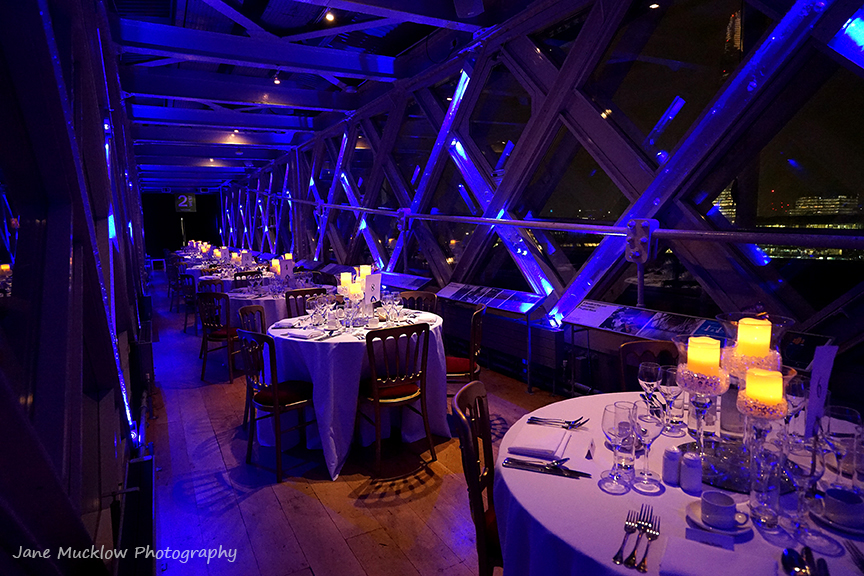 Photograph of the tables at an event in the walkway above Tower Bridge, by Jane Mucklow