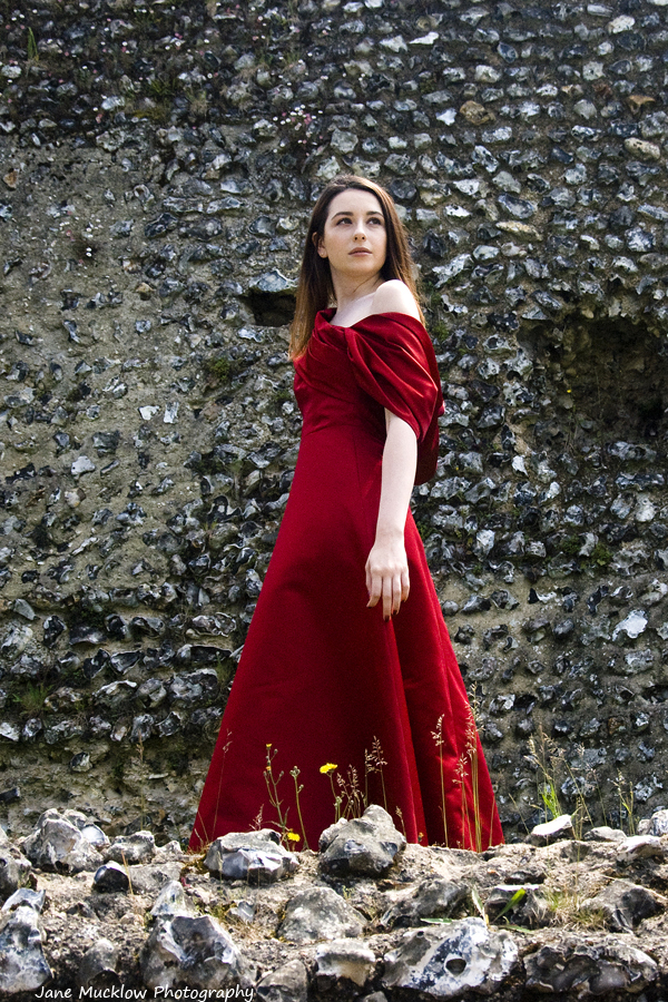 Photo of a red dress by Caroline Bruce Designer Dresses, by Jane Mucklow
