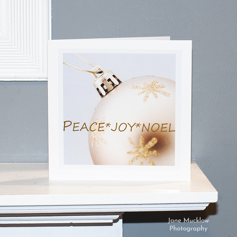 Gold bauble Christmas card on a shelf, photo by Jane Mucklow
